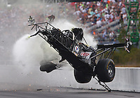 Mar 14, 2015; Gainesville, FL, USA; NHRA top fuel dragster driver Larry Dixon crashes after his car broke in half during qualifying for the Gatornationals at Auto Plus Raceway at Gainesville. Dixon walked away from the incident. Mandatory Credit: Mark J. Rebilas-