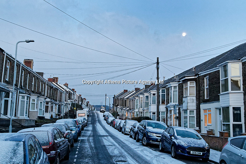 """Pictured: The lunar phonomenon known as Black Moon is seen over snow covered houses in Rhondda Street in the Mount Pleasant area of Swansea, caused by the """"Beast from the East"""", south Wales, UK. Wednesday 28 February 2018<br /> Re: Strong cold winds from the east have been affecting most parts of the UK with temperatures in some parts below zero."""