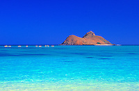 Kayakers paddle the turquoise waters of Lanikai beach