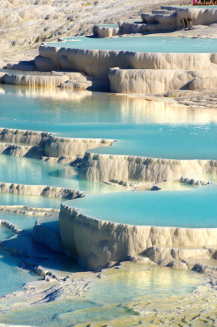 Photo & pictures  of Pamukkale Travetine Terrace, Turkey. Photography of the white Calcium carbonate rock formations. Buy as stock photos or as photo art prints. 2 Pamukkale travetine terrace water cascades, composed of white Calcium carbonate rock formations, Pamukkale, Anatolia, Turkey