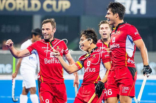 BHUBANESWAR (INDIA) - Thomas Briels (Belgie) (m) heeft de stand op 1-0 gebracht tijdens Belgie-Pakistan bij het WK Hockey heren.   links Sebastien Dockier (Belgie) , rechts Alexander Hendickx (Belgie) en Cedric Charlier (Belgie)  COPYRIGHT KOEN SUYK