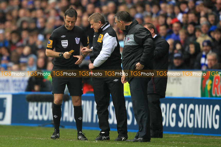 Ref Mr Clattenburg has to get a replacement yellow card after not being able to find his own - Reading vs Liverpool - Barclays Premier League Football at the Madejski Stadium - 13/04/13 - MANDATORY CREDIT: Simon Roe/TGSPHOTO - Self billing applies where appropriate - 0845 094 6026 - contact@tgsphoto.co.uk - NO UNPAID USE