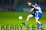 Gavin Crowley under pressure from DIT's Conor Loftus during the Sigerson Cup Quarter final game in Austin Stack Park, Tralee on Tuesday night last.