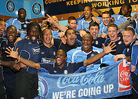 Nathan Ashton leads the celebrations in the dressing room as Wycombe Wanderers win promotion to Division One during Wycombe Wanderers vs Notts County, Coca Cola League Division Two Football at Adams Park on 2nd May 2009