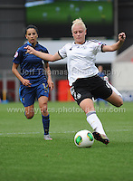 Merle Barth of Germany battles with Ghoutia Karchouni of France during the UEFA Womens U19 Semi-Final at Parc y Scarlets Wednesday 28th August 2013. All images are the copyright of Jeff Thomas Photography-www.jaypics.photoshelter.com-07837 386244-Any use of images must be authorised by the copyright owner.