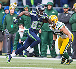 Seattle Seahawks  wide receiver Richardo Lockett (83) runs past Green Bay Packers linebacker Mick Perry (53) during the NFC Championship game at CenturyLink Field in Seattle, Washington on January 18, 2015.  The Seattle Seahawks beat the Green Bay Packers in overtime 28-22 for the NFC Championship Seattle.  ©2015. Photo by Jim Bryant, All Rights Reserved.