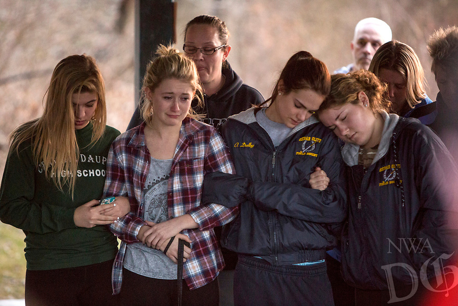 Family, friends and classmates hold a candlelight prayer vigil for 17-year-old Medard Kowalski in Fairview Township, Pa., Monday, March 16, 2015. Kowalski has been missing on the Susquehanna River since Dec. 1. (AP Photo/PennLive.com, Mark Pynes)