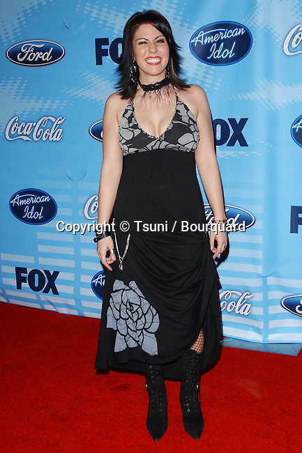 Gina Glocksen arriving at the AMERICAN IDOL, The Top 12 Final Contestants at the Astra Restaurant  in Los Angeles.<br /> <br /> full length<br /> smile<br /> eye contact