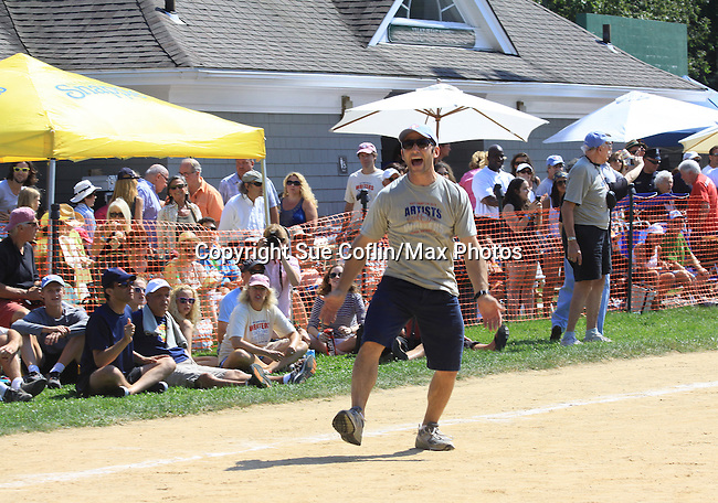 Actor Mark Feuerstein of USA's Royal Pains played in the Artists vs. Writers 64th Annual Celebrity Softball Game on August 25, 2012 at Herrick Park, East Hampton, New York benefiting East End Hospice, East Hampton Day Care Learning Center, Phoenix Houses of Long Island and The Retreat.  (Photo by Sue Coflin/Max Photos)
