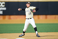 Wake Forest Demon Deacons third baseman Joe Napolitano (12) makes a throw to first base against the Marshall Thundering Herd at Wake Forest Baseball Park on February 17, 2014 in Winston-Salem, North Carolina.  The Demon Deacons defeated the Thundering Herd 4-3.  (Brian Westerholt/Four Seam Images)