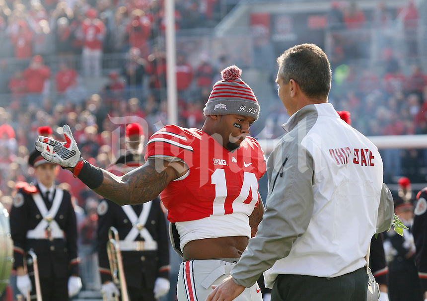 Ohio State Buckeyes linebacker Curtis Grant (14) high fives head coach Urban Meyer as he takes the field for Senior Day festivities prior to the NCAA football game against the Michigan Wolverines at Ohio Stadium on Nov. 29, 2014. The Buckeyes won 42-28. (Adam Cairns / The Columbus Dispatch)