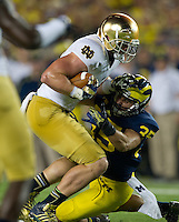 Tight end Troy Niklas (85) carries the ball as Michigan Wolverines linebacker Joe Bolden (35) defends.