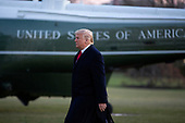 United States President Donald J. Trump walks to greet supporters on the South Lawn of the White House in Washington D.C., U.S. as he departs for a Keep America Great Rally in Battle Creek, Michigan on Wednesday, December 18, 2019. The United States House of Representatives is set to vote on two articles of impeachment against him later today.<br /> <br /> Credit: Stefani Reynolds / CNP