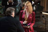 Guillermo del Toro accepts the Oscar&reg; for achievement in directing for work on &ldquo;The Shape of Water&rdquo; from Emma Stone during the live ABC Telecast of The 90th Oscars&reg; at the Dolby&reg; Theatre in Hollywood, CA on Sunday, March 4, 2018.<br /> *Editorial Use Only*<br /> CAP/PLF/AMPAS<br /> Supplied by Capital Pictures