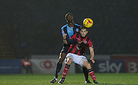 Shaun Miller of Morecambe holds off Anthony Stewart of Wycombe Wanderers during the Sky Bet League 2 match between Wycombe Wanderers and Morecambe at Adams Park, High Wycombe, England on 2 January 2016. Photo by Andy Rowland / PRiME Media Images