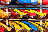 Rows of colorful kayak rentals.