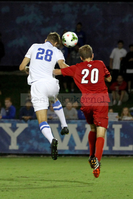 Kentucky freshman Stefan Stojkovic heads the ball during the Kentucky men's soccer match against Louisville at the Wendell and Vickie Bell Soccer Complex in Lexington, Ky., on Tuesday, September 23, 2014. Photo by Jonathan Krueger | Staff