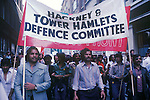 Ethnic Bengali asian local population march and demonstration against racism in the East End of London. UK. Hackney and Tower Hamlets Defence Committee banner leads the demo through Brick lane. 1978