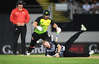 Colin Munro field off his own bowling as Aaron Finch backs up.<br /> New Zealand Black Caps v Australia.Tri-Series International Twenty20 cricket final. Eden Park, Auckland, New Zealand. Wednesday 21 February 2018. &copy; Copyright Photo: Andrew Cornaga / www.Photosport.nz