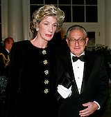 Former United States Secretary of State Dr. Henry A. Kissinger and his wife, Nancy, arrive at The White House in Washington, D.C. on October 29, 1997 for the State Dinner honoring President Jiang Zemin of China.<br /> Credit: Ron Sachs / CNP