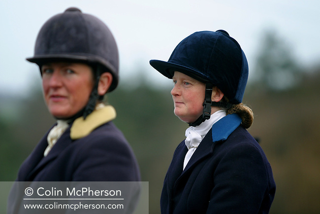 Two women foxhunters on horseback take a break during hunting with the Wynnstay Hunt. The Wynnstay Hunt, named after Sir Watkin Williams-Wynn, dated back to the 18th century and hunted on country estates in Shropshire, Cheshire and north Wales. Hunting with dogs in England and Wales became illegal on 18th February 2005 despite legal challenges to the ban and many hunts vowed to continue the ancient sport of foxhunting, risking prosecution..