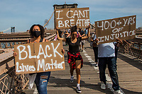 NEW YORK, NEW YORK - JUNE 04: People march by the Brooklyn Bridge on June 4, 2020 in Brooklyn, New York. Floyd's death, the most recent in a series of deaths of black Americans at the hands of the police, has set off days and nights of protests across the country. (Photo by Pablo Monsalve / VIEWpress via Getty Images)
