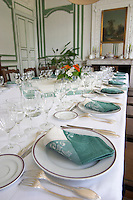 The magnificent lunch table set in traditional style with starched linen table cloth, white plates with golden decoration, silverware knives and forks, white and green linen napkins and many glasses for tasting the wine. Chateau de Cerons (Cérons) Sauternes Gironde Aquitaine France