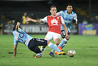 BOGOTA - COLOMBIA - 23-03-2016: Luis Seijas (Der.)  jugador de Independiente Santa Fe disputa el balón con Jorge Aguirre (Izq.) jugador de Atletico Junior, durante partido aplazado por la fecha 4 entre Independiente Santa Fe y Atletico Junior, de la Liga Aguila I-2016, en el estadio Nemesio Camacho El Campin de la ciudad de Bogota.  / Luis Seijas (R) player of Independiente Santa Fe struggles for the ball with Jorge Aguirre (L) player of Atletico Junior, during a postponed match of the date 4 between Independiente Santa Fe and Atletico Junior, for the Liga Aguila I -2016 at the Nemesio Camacho El Campin Stadium in Bogota city, Photo: VizzorImage / Luis Ramirez / Staff.