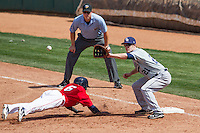 Oklahoma City RedHawks second baseman Enrique Hernandez (6) dives back to first as New Orleans Zephyrs first baseman Mark Canha (21) reaches for the ball during the Pacific League game at the Chickasaw Bricktown Ballpark against the on April 13, 2014 in Oklahoma City, Oklahoma.  The RedHawks defeated the Zephyrs 4-3.  (William Purnell/Four Seam Images)