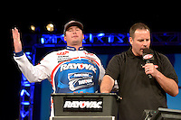 NWA Democrat-Gazette/BEN GOFF -- 04/25/15 Cody Meyer (left), FLW pro from Auburn, Calif., reacts as Master of Ceremonies Chris Jones announces his total during weigh-in on day three of the Walmart FLW Tour at Beaver Lake on Saturday Apr. 25, 2015 at the John Q. Hammons Center in Rogers. Meyer stood in 5th place after day three.