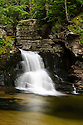 A portrait of a well proportioned ten foot drop in Cascade Brook, found along the Cascades Trail in Waterville Valley New Hampshire