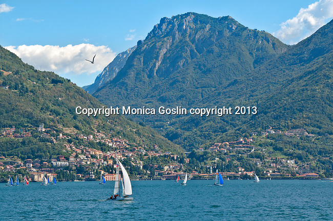 Sailing on Lake Como, Italy with the twon of Bellano in the background