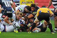 Forwards from both sides compete for possession of the ball as Leroy Houston looks to have grounded it over the line. Aviva Premiership match, between Sale Sharks and Bath Rugby on September 6, 2014 at the AJ Bell Stadium in Manchester, England. Photo by: Patrick Khachfe / Onside Images