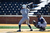Sergio Leon (4) of the Marshall Thundering Herd at bat against the Georgetown Hoyas at Wake Forest Baseball Park on February 15, 2014 in Winston-Salem, North Carolina.  The Thundering Herd defeated the Hoyas 5-1.  (Brian Westerholt/Four Seam Images)