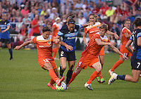 Kansas City, MO - Saturday May 07, 2016: FC Kansas City forward Shea Groom (2) against Houston Dash midfielder Amber Brooks (12) and defender Rebecca Moros (4) during a regular season National Women's Soccer League (NWSL) match at Swope Soccer Village. Houston won 2-1.