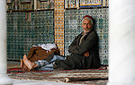A Tunisian sitting at the courtyard of the Mosque of the Barber, Kairouan, Tunisia.