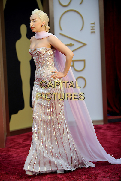 HOLLYWOOD, CA - MARCH 2: Lady Gaga (Stefani Joanne Angelina Germanotta) arriving to the 2014 Oscars at the Hollywood and Highland Center in Hollywood, California. March 2, 2014.  <br /> CAP/MPI/mpi99<br /> &copy;mpi99/MediaPunch/Capital Pictures