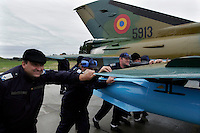 MiG-21 F ground crew of the 95th Air Force Base from the Romanian Air Force. BOLD AVENGER 2007 (BAR 07), a NATO  air exercise at Ørland Main Air Station, Norway. BAR 07 involved air forces from 13 NATO member nations: Belgium, Canada, the Czech Republic, France, Germany, Greece, Norway, Poland, Romania, Spain, Turkey, the United Kingdom and the United States of America..The exercise was designed to provide training for units in tactical air operations, involving over 100 aircraft, including combat, tanker and airborne early warning aircraft and about 1,450 personnel.