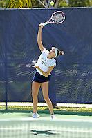 18 March 2012:  FIU's Sarah McLean serves the ball during her singles match against Columbia's Nicole Bartnik as the Columbia Lions defeated the FIU Golden Panthers, 5-2, at University Park in Miami, Florida.