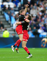 Chris Ashton and Marcelo Bosch of Saracens celebrate at the final whistle. European Rugby Champions Cup Final, between Saracens and Racing 92 on May 14, 2016 at the Grand Stade de Lyon in Lyon, France. Photo by: Patrick Khachfe / Onside Images