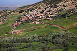 Berber village on green north west facing foothills of Atlas Mountains on Tiz-n-Tichka road Morocco north Africa