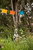 USA, California, Big Sur, Esalen, Buddha and prayer flags at the Gazebo School