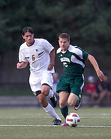 George Mason University midfielder Derek Markheim (5) brings the ball forward as Boston College midfielder Steve Rose (6) defends. Boston College defeated George Mason University, 3-2, at Newton Soccer Field, August 26, 2011.