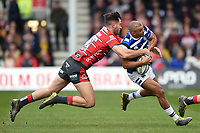 Jonathan Joseph of Bath Rugby is tackled by Mark Atkinson of Gloucester Rugby. Gallagher Premiership match, between Gloucester Rugby and Bath Rugby on April 13, 2019 at Kingsholm Stadium in Gloucester, England. Photo by: Patrick Khachfe / Onside Images