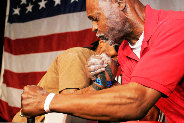 "Harry Wilson, left, battles Milt Christmas at the 28th Annual Big Apple Grapple, held in New York City on March 19, 2005.  The tournament is the first in the 2005 New York Arm Wrestling Association's ""Golden Arm Series""."