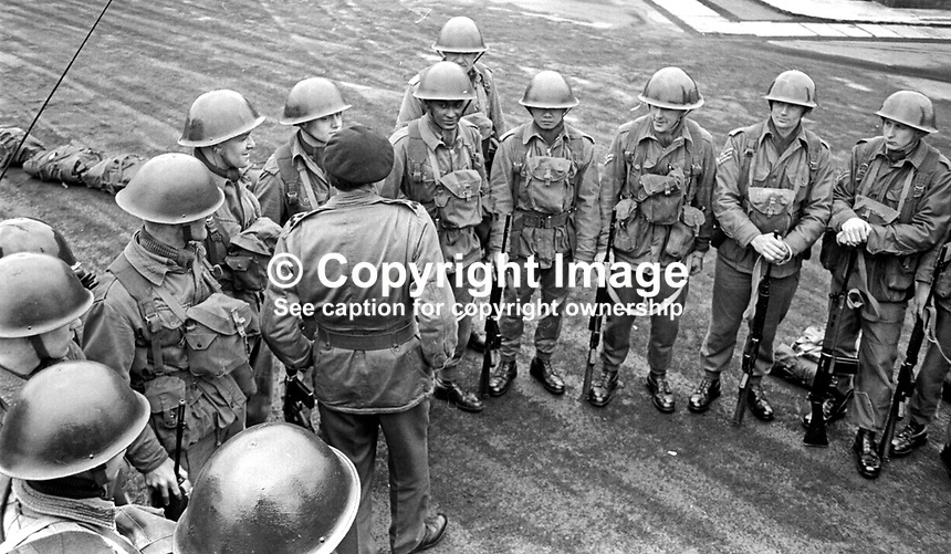 Brigadier Peter Hudson instructs a squad of soldiers of the Queen's Regiment about the nature of their guard duties at public facilities in N Ireland. The regiment was already stationed at Palace Barracks, on the outskirts of Belfast, prior to the unrest in N Ireland. 23rd April 2015. 196904230156a<br /> <br /> Copyright Image from Victor Patterson, 54 Dorchester Park, Belfast, UK, BT9 6RJ<br /> <br /> t1: +44 28 9066 1296<br /> t2: +44 28 9002 2446<br /> m: +44 7802 353836<br /> <br /> e1: victorpatterson@me.com<br /> e2: victorpatterson@gmail.com<br /> <br /> IMPORTANT: My Terms and Conditions of Business are at www.victorpatterson.com