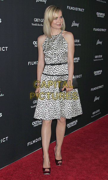 "Radha Mitchell.""Olympus Has Fallen"" Los Angeles Premiere held at ArcLight Cinemas Cinerama Dome, Hollywood, California, USA..March 18th, 2013.full length white brown black sleeveless leopard print dress clutch bag.CAP/ADM/RE.©Russ Elliot/AdMedia/Capital Pictures."