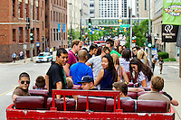 Visitors to downtown Chicago Ill explore the city atop a double decker tour bus.