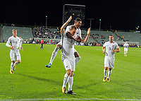 James Musa leaps onto Chris Wood as he celebrates his hat-trick during the first leg of FIFA World Cup Russia 2018 qualifying football match between the New Zealand All Whites and Solomon Islands at QBE Stadium in Albany, New Zealand on Friday, 1 September 2017. Photo: Dave Lintott / lintottphoto.co.nz