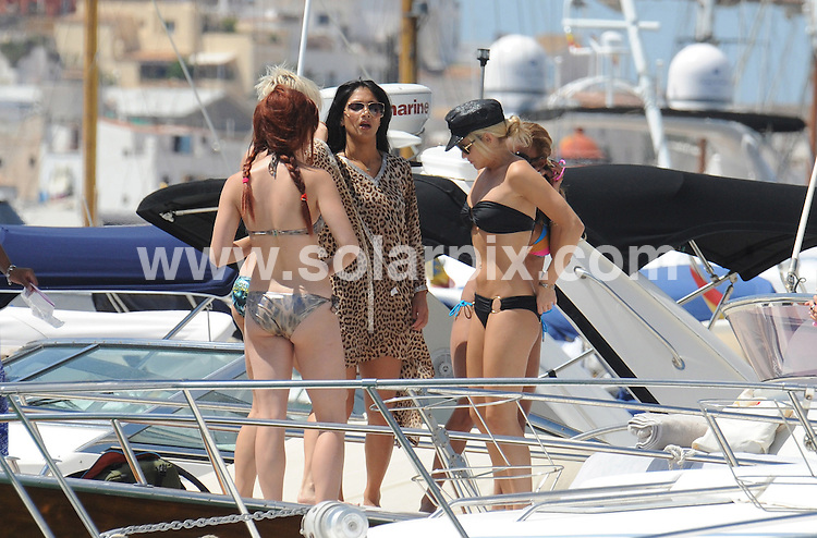 ** ALL ROUND PICTURES FROM SOLARPIX.COM**.**WORLDWIDE SYNDICATION RIGHTS EXCLUDING SPAIN - NO PUBLICATION IN SPAIN**.Nicole Scherzinger, current girlfriend of Lewis Hamilton, with her group The Pussycat Dolls, taking a break, relaxing on a boat in Ibiza. 18th August 2008..This pic: Nicole Scherzinger and The Pussycat Dolls..JOB REF: 7055 RAM       DATE: 18_08_2008.**MUST CREDIT SOLARPIX.COM OR DOUBLE FEE WILL BE CHARGED* *UNDER NO CIRCUMSTANCES IS THIS IMAGE TO BE REPRODUCED FOR ANY ONLINE EDITION WITHOUT PRIOR PERMISSION*